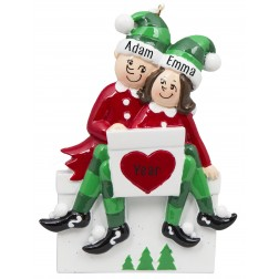 Image of Elf Sitting on Gift Box Couple